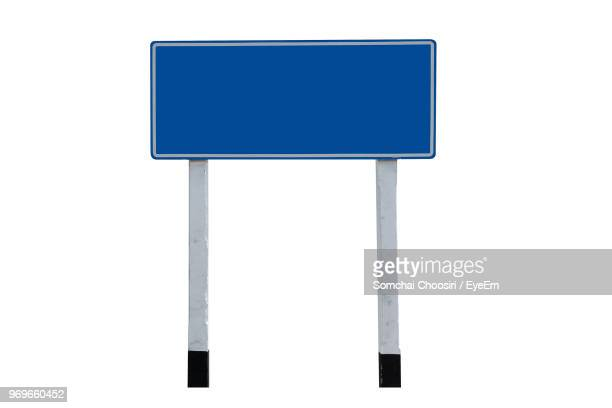 close-up of blank billboard against white background - road sign stock pictures, royalty-free photos & images