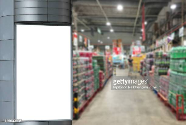close-up of blank billboard in supermarket - aisle stock pictures, royalty-free photos & images