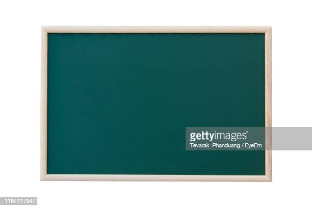 close-up of blank blackboard against white background - blackboard stock pictures, royalty-free photos & images