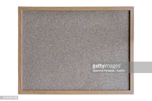 close-up of blank bulletin board on white background - bulletin board stock pictures, royalty-free photos & images