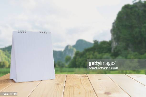 Close-Up Of Blank Calendar On Table