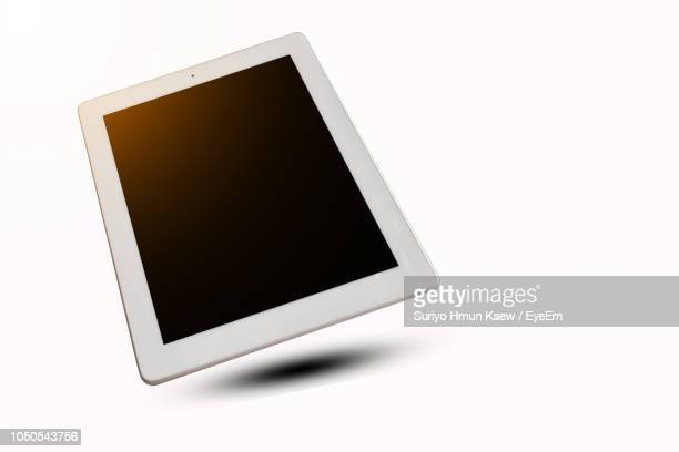 close-up of blank digital tablet against white background - tablet pc stock-fotos und bilder