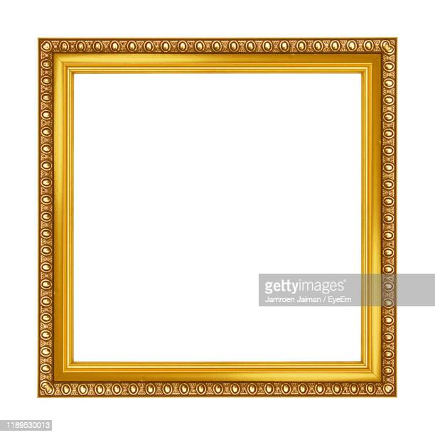close-up of blank frame against white background - square composition stock pictures, royalty-free photos & images
