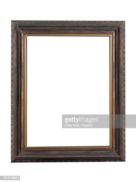 Close-Up Of Blank Frame Against White Background