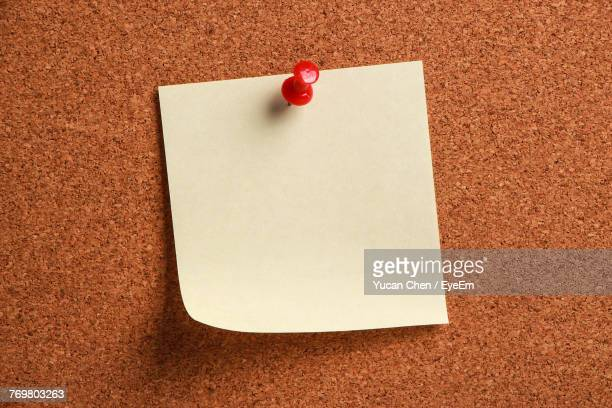 Close-Up Of Blank Note On Bulletin Board