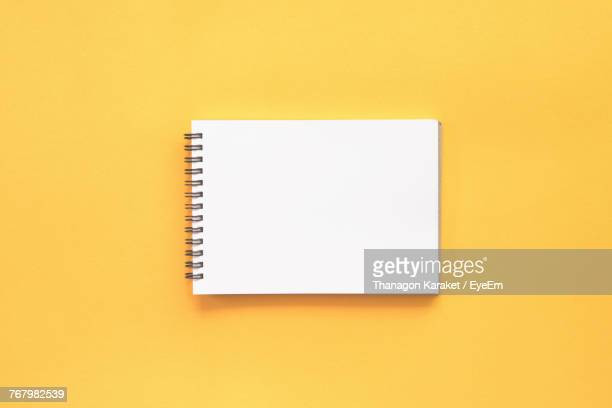 Close-Up Of Blank Paper Against Yellow Background