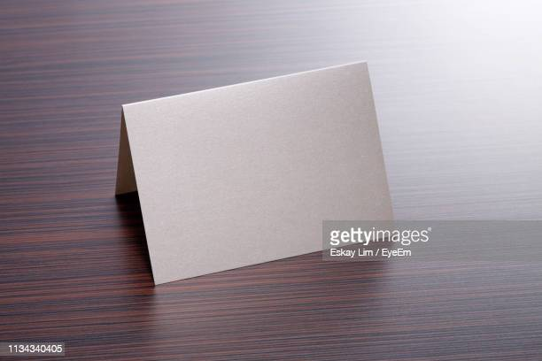 close-up of blank paper in envelope on table - greeting card bildbanksfoton och bilder