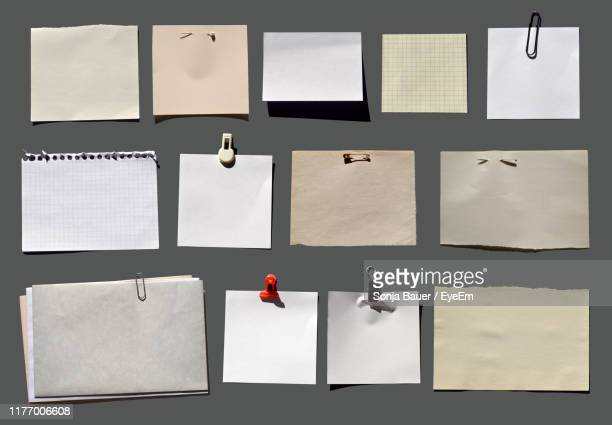 close-up of blank papers on bulletin board - bulletin board stock pictures, royalty-free photos & images