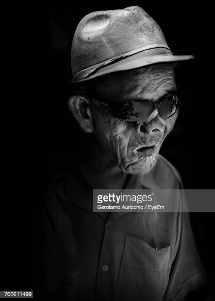 Close-Up Of Blind Man Against Black Background