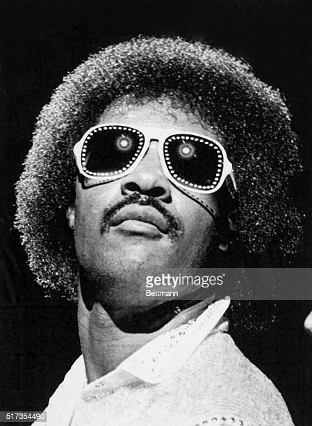 Close-up of blind singer and pianist Stevie Wonder, in studded sunglasses, performing for 62,500 people attending Superfest at the Rose Bowl in...