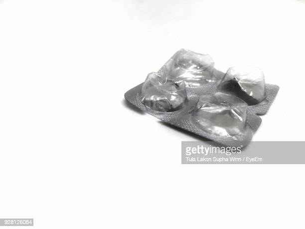 close-up of blister pack over white background - pill blister stock pictures, royalty-free photos & images