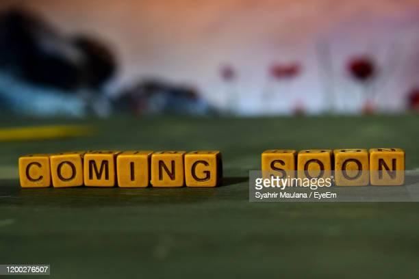 close-up of block shape with text over table - coming soon stock pictures, royalty-free photos & images