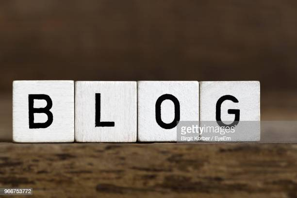 close-up of blocks with blog text on table - western script stock pictures, royalty-free photos & images