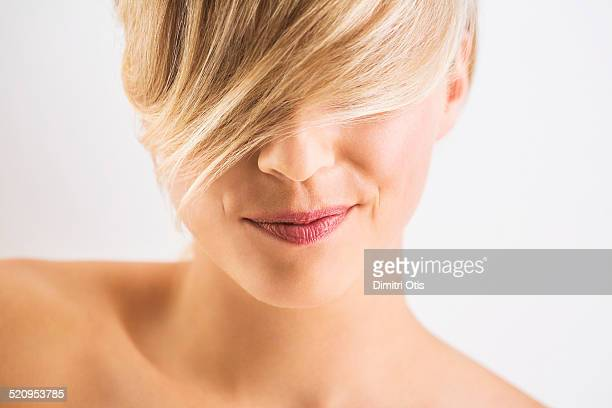 Close-up of blonde woman with quirky smile