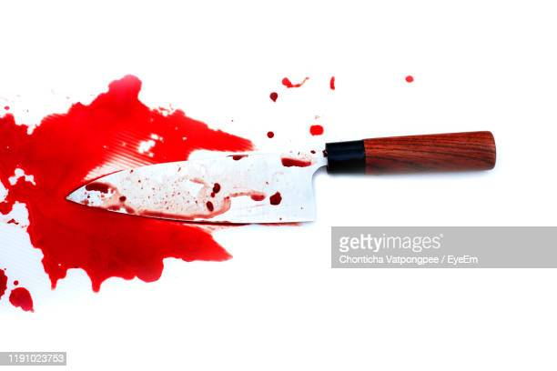 close-up of blood against white background - kitchen knife stock pictures, royalty-free photos & images