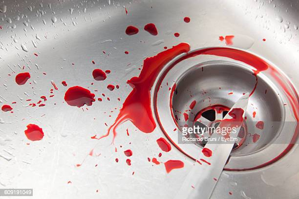 close-up of blood drops on kitchen knife over sink - blood in sink stock pictures, royalty-free photos & images