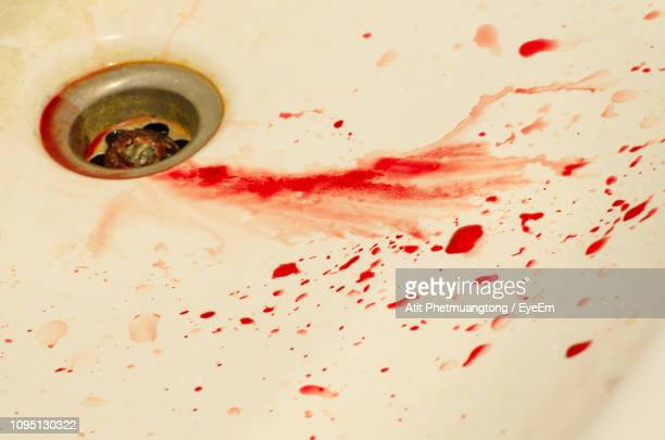 close-up of blood in sink - blood in sink stock pictures, royalty-free photos & images