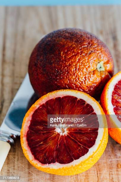 Close-Up Of Blood Oranges On Table