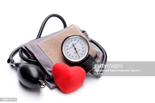 Close-Up Of Blood Pressure Gauge On White Background
