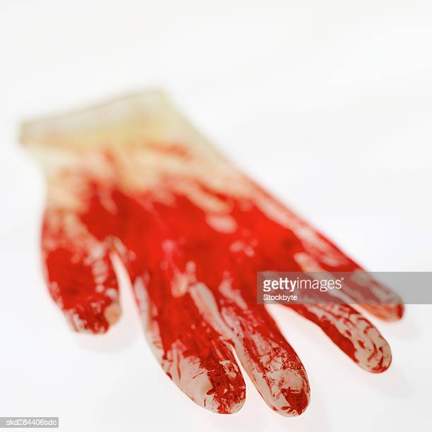Close-up of blood stained on glove