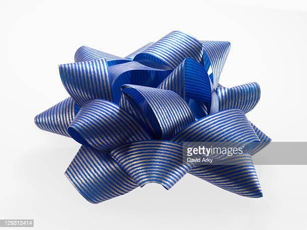 Close-up of blue and silver ribbon, studio shot