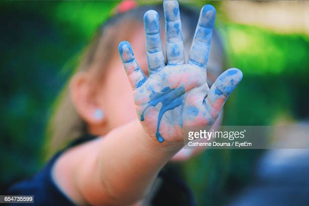 Close-Up Of Blue Colored Hand