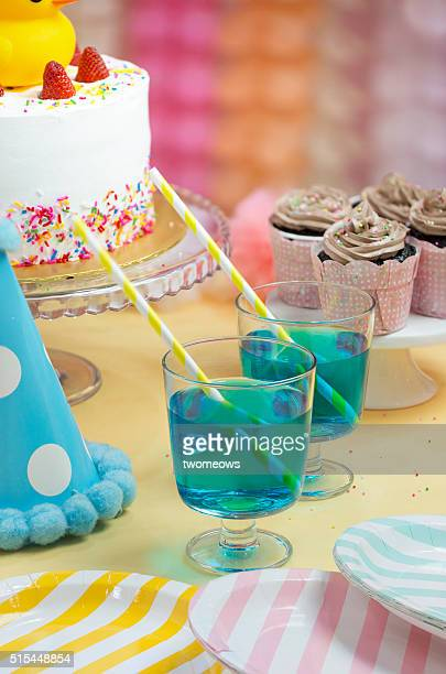 Closeup of blue colour cocktail drinks on the party table with straw.