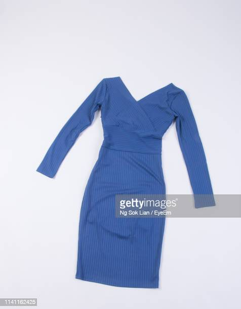close-up of blue dress on gray background - blue dress stock pictures, royalty-free photos & images