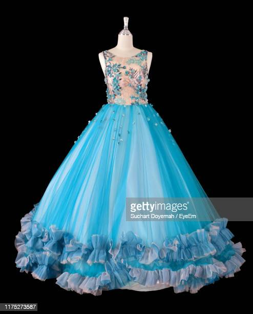 close-up of blue dress on mannequin against black background - evening gown stock pictures, royalty-free photos & images