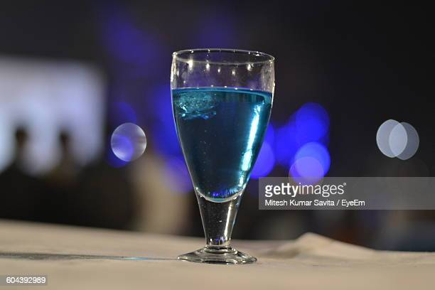 Close-Up Of Blue Drink On Table