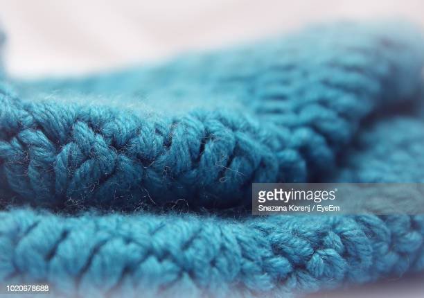 close-up of blue fabric against white background - wool stock pictures, royalty-free photos & images