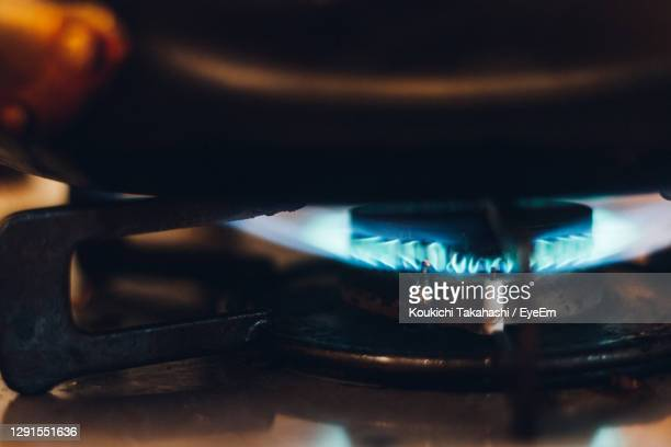 close-up of blue flame gas stove at cooking time - koukichi stock pictures, royalty-free photos & images