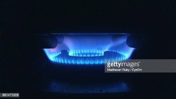 Close-Up Of Blue Flames Of Stove