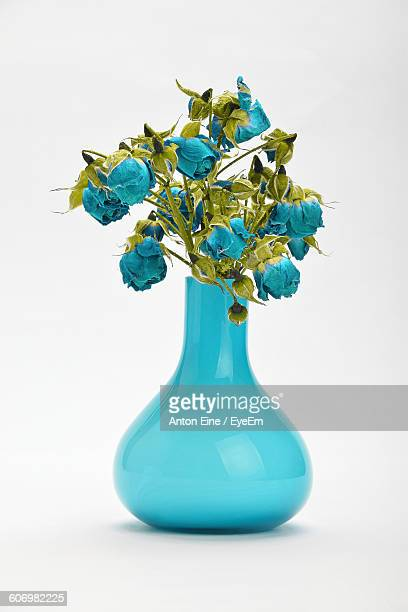 Close-Up Of Blue Flower Vase Against White Background