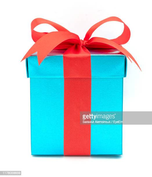 close-up of blue gift box against white background - gift box stock pictures, royalty-free photos & images