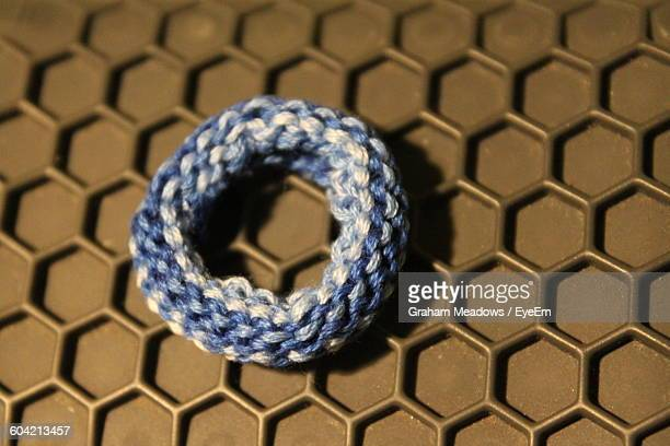 Close-Up Of Blue Hair Elastic On Metal