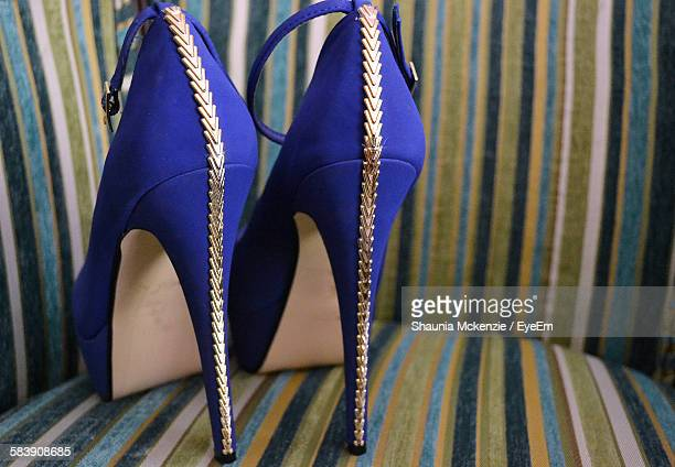 Close-Up Of Blue High Heels In Chair