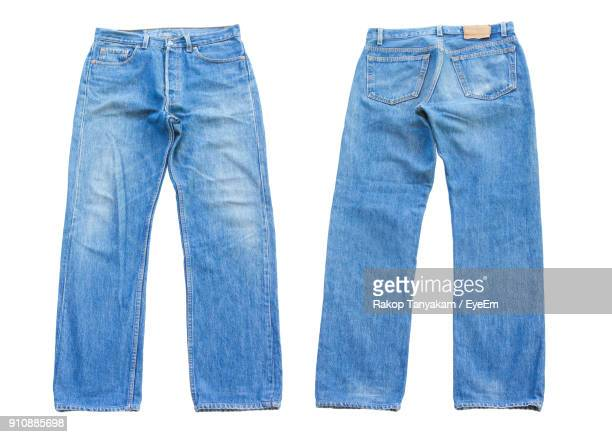 close-up of blue jeans over white background - spijkerbroek stockfoto's en -beelden
