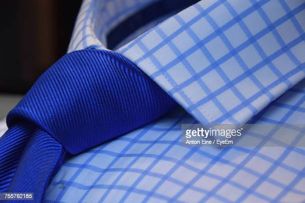Close-Up Of Blue Necktie On Checked Pattern Shirt At Store
