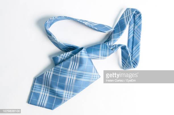close-up of blue necktie over white background - krawatte stock-fotos und bilder