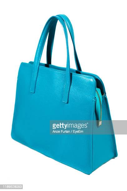 close-up of blue purse over white background - blue purse stock pictures, royalty-free photos & images