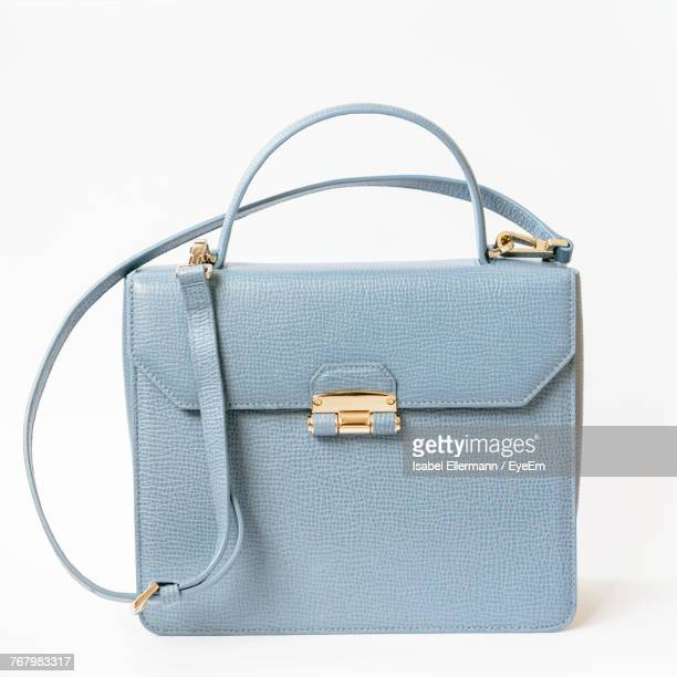close-up of blue purse over white background - borsetta da sera foto e immagini stock