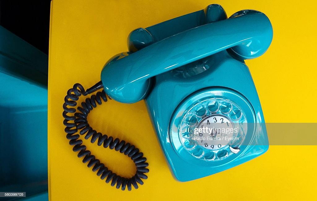 Close-Up Of Blue Retro Telephone On Table : Stock-Foto