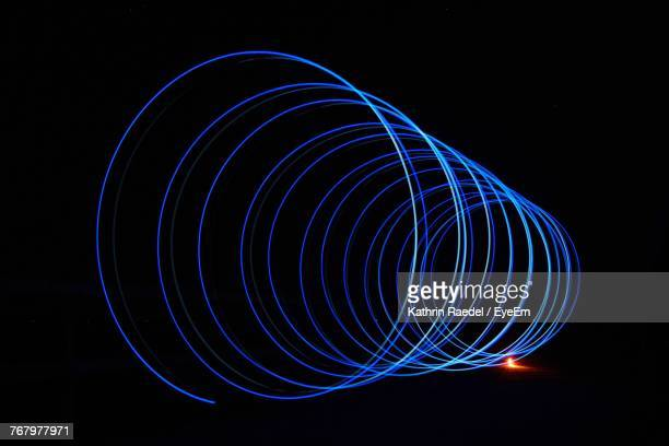 Close-Up Of Blue Spiral Shaped Light Trails At Night