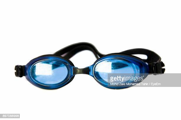 Close-Up Of Blue Swimming Goggles Over White Background