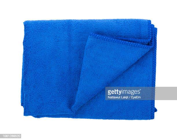 close-up of blue towel against white background - towel stock pictures, royalty-free photos & images
