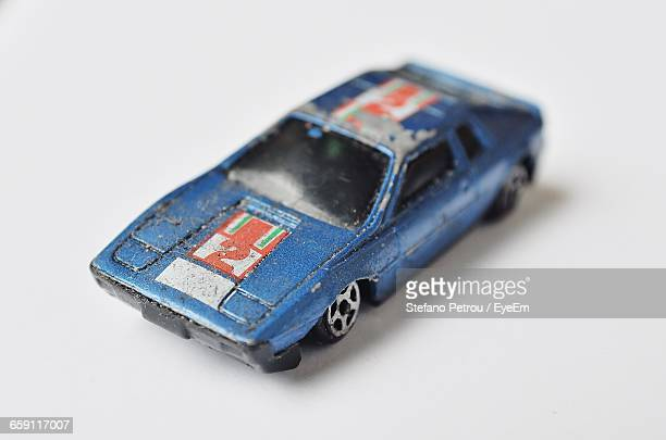 Close-Up Of Blue Toy Car On Table