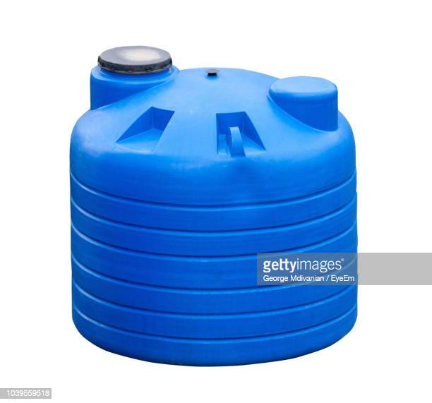 close-up of blue water tank against white background - water tower storage tank stock pictures, royalty-free photos & images
