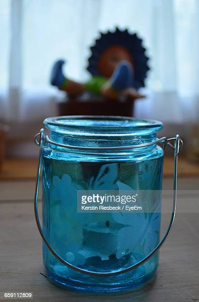 Close-Up Of Blue Windlicht On Table At Home