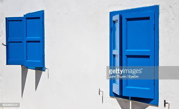 close-up of blue window on white house - john mahon stock pictures, royalty-free photos & images